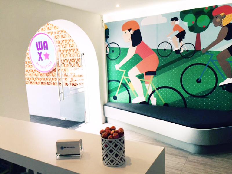 Wax Revolution Entrance Cycling Woman Wall Mural Sam Osborne